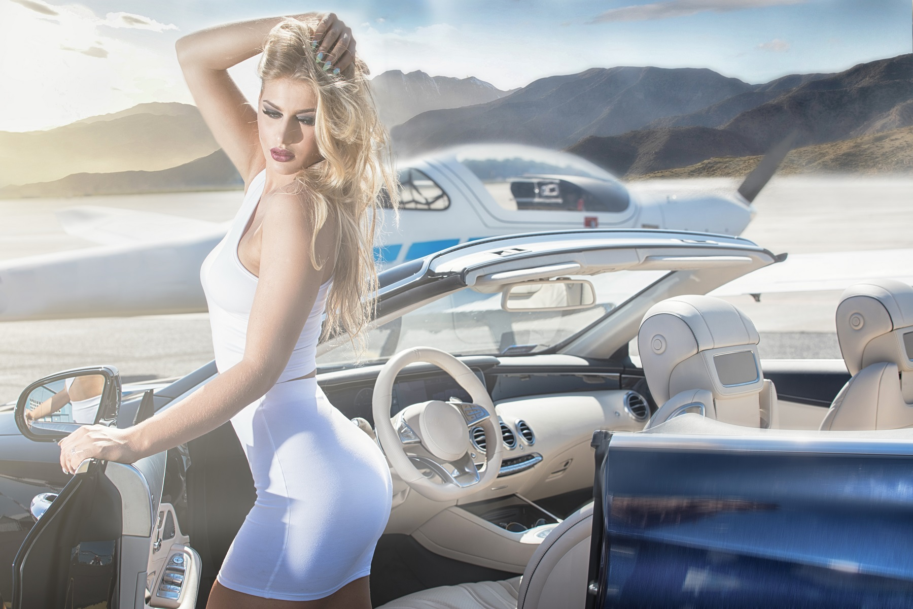 Sexy woman with luxury car and airplane.